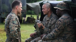Cpl. Seth Dixon (left), a field radio operator with 3rd Battalion, 3rd Marine Regiment, and Blue Ridge, Georgia, native, speaks to Cpl. Terry Summerfield (center), a technician with 3rd Bn., 3rd Marines, and San Diego native, and Cpl. John Boyd (right), a field radio operator with 3rd Bn., 3rd Marines, and Lagrange, Georgia, native, at the Boondocker Training Area aboard Marine Corps Base Hawaii during training exercise Island Viper, Sept. 22, 2015. The purpose of Island Viper was to help companies within the battalion ensure their service members have been properly trained and have met all training requirements before deployment.