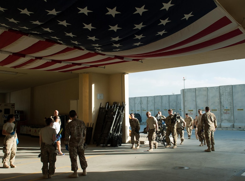 U.S. Airmen and Soldiers transport an injured Afghan National Defense and Security Forces soldier who sustained trauma from a gunshot to the Craig Joint Theater Hospital for surgery at Bagram Airfield Afghanistan, Sept. 26, 2015. The CJTH provides surgical capabilities in trauma, general surgery, orthopedics, neurosurgery, urology, vascular surgery and otolaryngology, all of which are critical to helping 98 percent of patients who come to the hospital survive their injuries. (U.S. Air Force photo by Tech. Sgt. Joseph Swafford/Released)