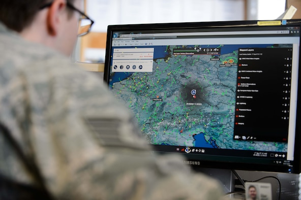 A 7th Weather Squadron Airmen looks at weather patterns near his location during a daily forecasting competition during Cadre Focus Sept. 17, 2015, at Grafenwohr Training Area, Germany. Approximately 30 Airmen attended Cadre Focus 2015 to sharpen their weather forecasting and Army combat skills. (U.S. Air Force photo/Staff Sgt. Armando A. Schwier-Morales)