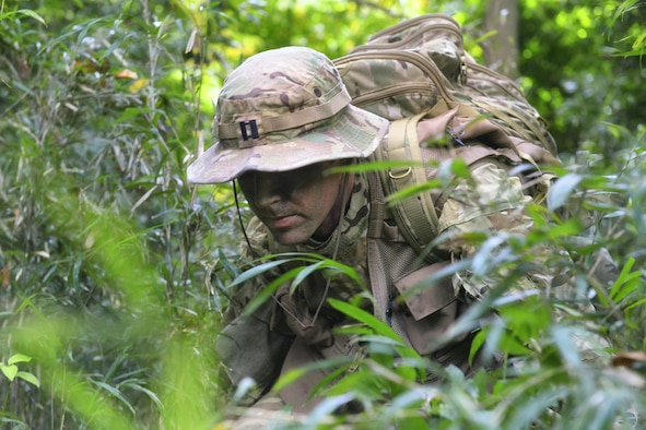 Capt. Michael Farrara, a 459th Airlift Squadron C-12 pilot, attempts to move quietly through the bamboo during a survival, evasion, resistance and escape combat survival training at Tama Hills Recreation Area, Japan, Sept. 22, 2015. Students are taught to move quietly to avoid capture. (U.S. Air Force photo/Airman 1st Class Elizabeth Baker)