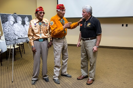 Navajo Code Talkers Samuel T. Holiday (left), and Roy Hawthorn (center), speak with Ray Lebron (right) during a tour of Camp Pendleton, Calif., Sept. 28, 2015.  The Navajo Code Talkers took part in every assault the U.S. Marines conducted in the Pacific from 1942 to 1945.  They served in all six Marine divisions, Marine Raider Battalions and Marine parachute units transmitting messages by telephone and radio in their native language that enemy forces were never able to break.  (U.S. Marine Corps photo by Lance Cpl. Adrianna R. Lincoln 1st Marine Division Combat Camera/Released)