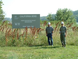 Steve Rothe, USACE Project Manager - retired (right), along with Marty Timmerwilke, USACE Plan Formulator - retired (left), at the Section 1135 California Bend habitat restoration project site, near Blair, Nebraska in 2003.