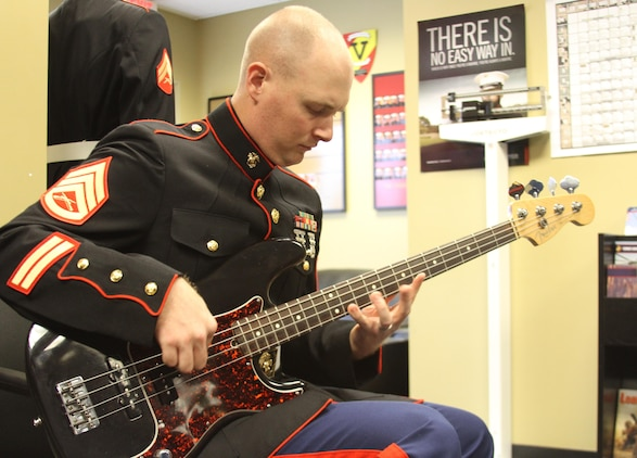 U.S. Marine Corps Staff Sgt. Justin Billingsley, takes a short break from his duties as a Marine Corps recruiter to keep his skills sharp on the electric bass, at Recruiting Substation Richmond South, Sept. 29, 2015. Billingsley, a Chesterfield native, recently returned to his hometown as a recruiter, 12 years after enlisting into the Marine Corps as a musician. (U.S. Marine Corps photo by Sgt. Aaron Diamant/Released)