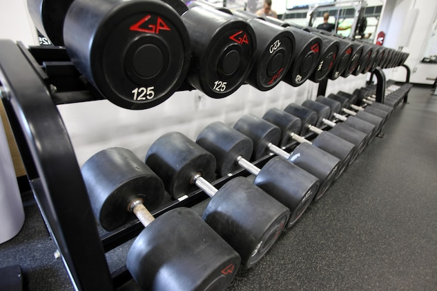 Dumbbells are lined up on a weight rack in the Hancock gym at Marine Corps Air Station Cherry Point, Sept. 27, 2015.  The Hancock gym and Devil Dog gym's hours will increase by more than 40 hours per week beginning Oct. 1, 2015, collectively between the two fitness facilities. The change in hours comes from the concerns of Marines on the air station being heard by their senior leadership. (U.S. Marine Corps photo by Lance Cpl. Jason Jimenez/Released)