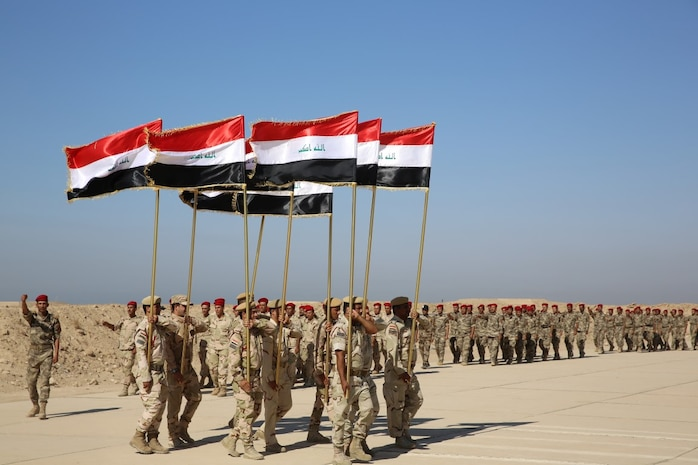 Members of the Popular Mobilization Program march in formation with Iraqi national flags during a graduation ceremony at Al Taqaddum Air Base, Iraq, Sept. 3, 2015. The Popular Mobilization Program is an Iraqi-led, Operation Inherent Resolve program that trains volunteer tribal forces in leadership, small unit tactics and urban warfare to ultimately serve with Iraqi Security Forces in their battle to defeat the Islamic State of Iraq and the Levant and ensure the safety and security of its citizens. (U.S. Marine Corps photo by Cpl. John Baker / released)