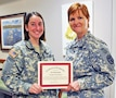 Capt. Tiffany Bujak, Team 5 Farrelly Health Clinic provider receives the Army Provider Level Satisfaction Survey Provider of the Quarter award from Irwin Army Community Hospital Commander Col. Risa Ware for having the highest total satisfaction scores by a provider over the past 90 days. Returned APPLS surveys provide Soldiers and family members an opportunity to improve medical readiness.