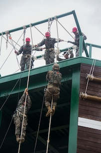 U.S. Marine Lance Cpl. Crosby, bottom right, races up a rope tower during a company competition at Korea Marine Exchange Program 15-12 at Yooghuk Dae, Munseu San Mountain, Republic of Korea, Sept. 11, 2015. The U.S. and ROK Marines competed for the fastest integrated company in rappelling, rocking climbing and rope climbing before a sprint to the finish line. KMEP 15-12 is a bilateral training exercise that enhances the ROK and U.S. alliance, promotes stability on the Korean Peninsula and strengthens ROK and U.S. military capabilities and interoperability. Crosby, from Glendale, Arizona, is a rifleman with Fox Company, 2nd Battalion, 3rd Marine Division and attached through the Unit Deployment Program to III Marine Expeditionary Force. The ROK Marines are with 11th Battalion, 1st Regiment, 2nd Marine Division, ROK Headquarters Marine Corps.