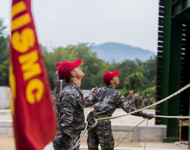Republic of Korea Marine ranger instructors act as belay men during a company competition among integrated teams of ROK and U.S. Marines during Korean Marine Exchange Program at Yooghuk Dae, Munseu San Mountain, Republic of Korea, Sept. 11, 2015. The U.S. and ROK Marines competed for the fastest company in rappelling, rocking climbing and rope climbing before a sprint to the finish line. KMEP 15-12 is a bilateral training exercise that enhances the ROK and U.S. alliance, promotes stability on the Korean Peninsula and strengthens ROK and U.S. military capabilities and interoperability. The ROK Marines are with 11th Battalion, 1st Regiment, 2nd Marine Division, ROK Headquarters Marine Corps.