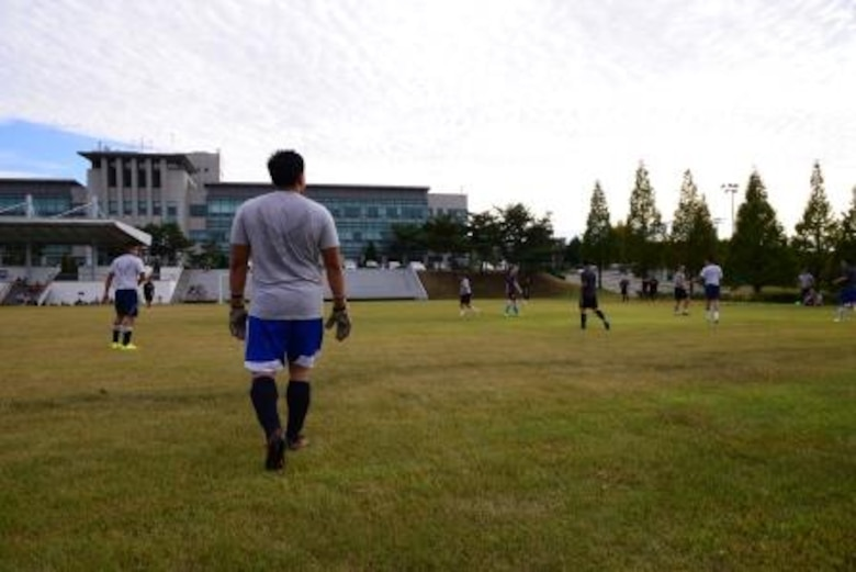 Team Osan members play soccer during the second annual Osan Cup Sept. 29, 2015, at Osan Air Base, Republic of Korea. Many Team Osan members were able to ake a day off, play their favorite sport or game, and focus on resiliency during the two-day event. (U.S. Air Force photo by Staff Sgt. Benjamin Sutton)