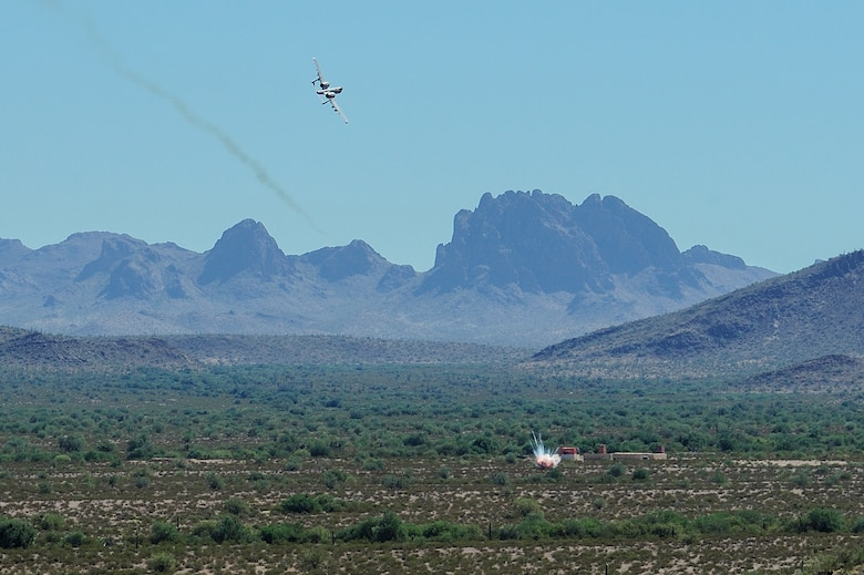 A U.S. Air Force A-10C Thunderbolt II assigned to the 357th Fighter Squadron eliminates a target while utilizing the guidance of British Armed Forces joint tactical air controllers at Barry M. Goldwater Range, Ariz., Sept. 23, 2015. The British Armed Forces JTACs are the link between air and ground communications and are charged with ensuring that they can direct any ordnance that leaves an aircraft while protecting civilians and friendly troops at all times. (U.S. Air Force photo by Airman 1st Class Chris Drzazgowski/Released)