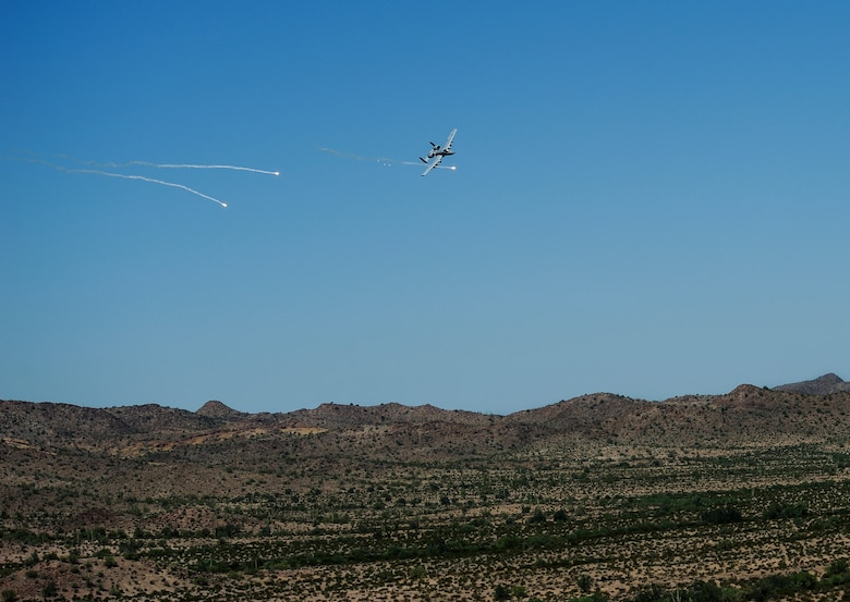 A U.S. Air Force A-10C Thunderbolt II assigned to the 357th Fighter Squadron executes defensive maneuvering in correspondence with British Armed Forces joint tactical air controllers at Barry M. Goldwater Range, Ariz., Sept. 23, 2015. JTACs relay information to pilots such as target location, threat type and ordnance delivery to eliminate enemy forces. (U.S. Air Force photo by Airman 1st Class Chris Drzazgowski/Released)
