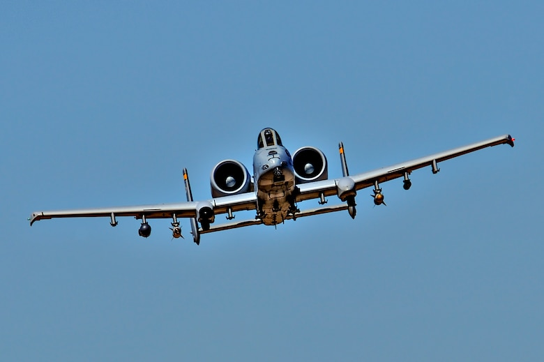 A U.S. Air Force A-10C Thunderbolt II assigned to the 357th Fighter Squadron flies while being directed by British Armed Forces joint tactical air controllers at Barry M. Goldwater Range, Ariz., Sept. 23, 2015. The frequent air traffic at BMGR provided the JTACs with a fast track to becoming more proficient in their career field. (U.S. Air Force photo by Airman 1st Class Chris Drzazgowski/Released)