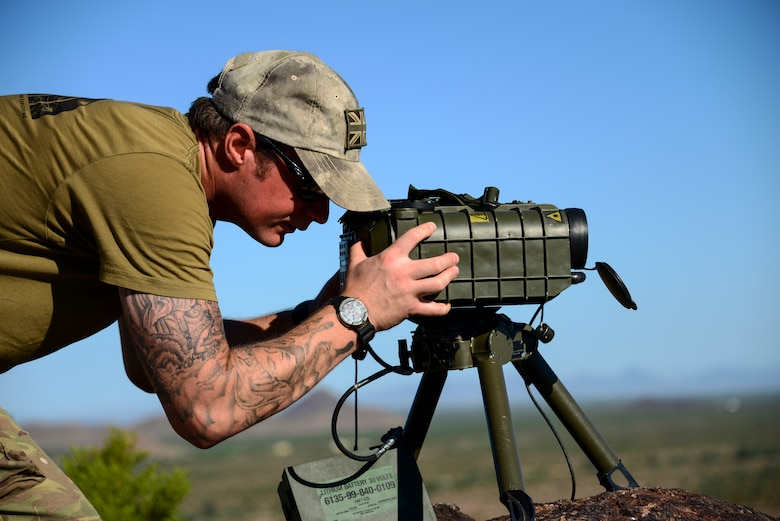 Royal Air Force Cpl. Paul Marshall, RAF Regiment joint tactical air controller, uses a laser targeting system to mark a preemptive target at Barry M. Goldwater Range, Ariz., Sept. 23, 2015. The targeting system provides an indicator for fighter pilots to eliminate enemy forces with precision. (U.S. Air Force photo by Airman 1st Class Chris Drzazgowski/Released)