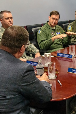 U.S. Rep. Denny Heck, of Washington's 10th District, listens to Col. Scott Snyder, the 446th Operations Group commander, brief him on 446th Reserve Airlift Wing C-17 operations, at McChord Field. Heck's purpose for visiting the Reserve unit was to get an update on the status of the wing. Various 446th members briefed the Congressman on medical service missions, and Operation Deep Freeze. (U.S. Air Force Reserve photo by Jake Chappelle)