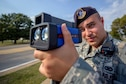 Staff Sgt. Eric Salazar monitors vehicle speeds at Vance Air Force Base, Oklahoma, Sept. 29. Salazar is a Defender with Vance's 71st Security Forces Squadron. (U.S. Air Force photo / David Poe)