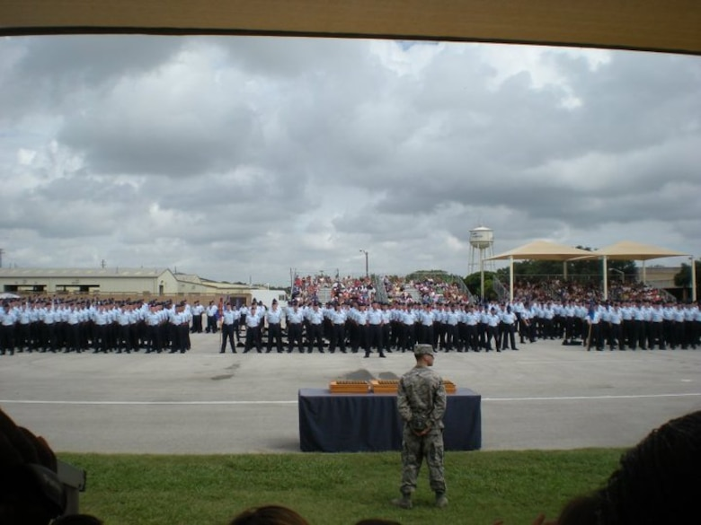 Hundreds of Airmen line up for their coin ceremony at Lackland Air Force Base, San Antonio, Texas, July 22, 2010. The Airmen received their coins after completing basic military training. (Photo courtesy of Megan Liechti)