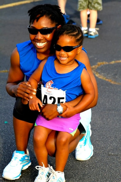 Tech. Sgt. Curnita Brisby, First-Term Airman Center NCO in charge, poses with her daughter, Joy Brisby, 6, after a race. Brisby and her daughter run together constantly and have participated in a number of 5Ks together. Joy motivates her mother to complete her races and was a huge support system from  home as Brisby completed the Air Force Marathon. (Courtesy photo)
