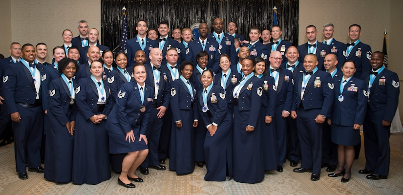 Joint Base Charleston's newest Senior NCO's gather for a group photo during the SNCO Induction ceremony Sept. 25, 2015, at the Charleston Club on JB Charleston – Air Base, S.C. This ceremony is a time honored tradition that recognizes Airmen making the transition from NCO to SNCO. (U.S. Air Force photo/Airman 1st Class Clayton Cupit)
