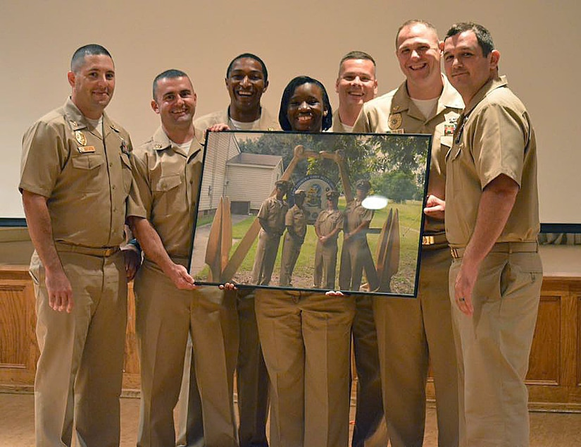 (left to right) Master-at-Arms Chief Petty Officer Rick Crowell, Electrician's Mate Chief Petty Officer Thomas Byers, Mineman Chief Petty Officer David Toyloy, Logistic Specialist Chief Petty Officer Ashley Cooper, Yeoman Chief Petty Officer Chris Byrd, Fire Controlman Chief Petty Officer Rob McElroy, and Mineman Chief Petty Officer Michael Taylor pose for a group photo during this year's Khaki Ball held at the Redbank Club, Joint Base Charleston – Weapons Station, Sept. 26, 2015. The event is held throughout the U.S. Navy each year to welcome the newly pinned Chiefs, their spouses and significant others into the Chiefs Mess. One of the proudest days in a Sailor's life is the date when he or she dons the khaki uniform. (Courtesy Photo)