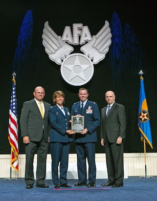 Col. Susan Melton and Lt. Col. Robert Taylor accept the Air Force Association Air National Guard Outstanding Unit Award for the 151st Maintenance Group at a ceremony in National Harbor, Md. on Sept. 14, 2015. (Photo by Brittany Gray/Released)