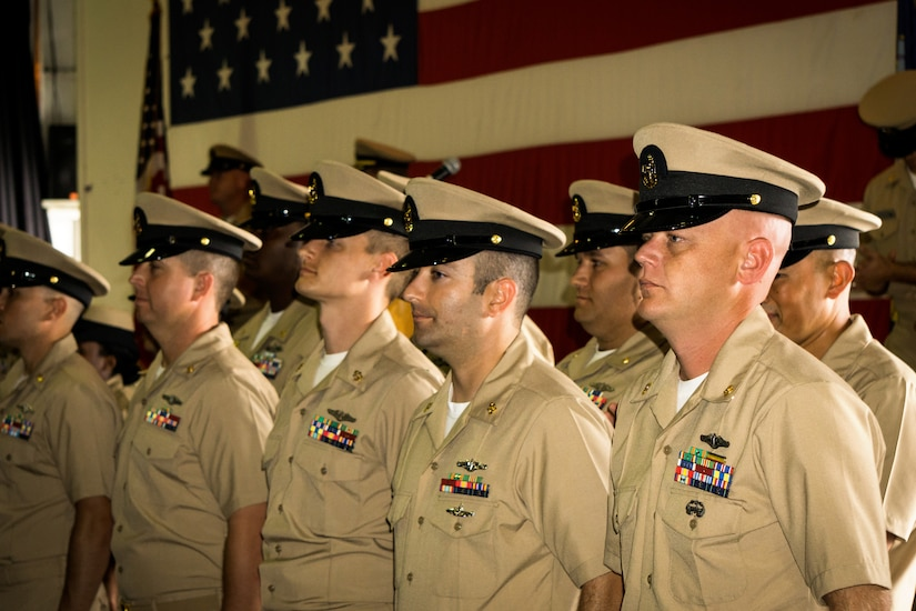 Newly selected Chiefs don their combination covers for the first time during the chief pinning ceremony held at the Nuclear Power Training Unit, Joint Base Charleston – Weapons Station, Sept 16, 2015. The ceremony welcomed 25 new members to the Chief's Mess.  This is a significant milestone in every Sailor's career, representing more than a century of heritage and tradition. (U.S. Navy photo/Machinist's Mate Chief Petty Officer Justin D. Foil)