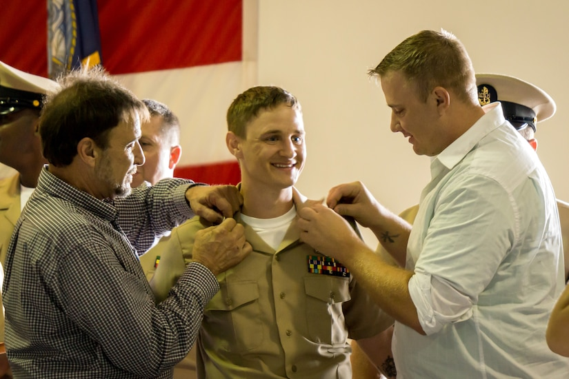 Electronics Technician Chief Petty Officer Joe Post gets his anchors pinned on by Senior Chief Electronics Technician (ret) Dale Stevick (left) and, his brother, Aviation Electrician's Mate Petty Officer 1st Class Thomas Post at the Nuclear Power Training Unit, Joint Base Charleston – Weapons Station, Sept 16, 2015. The ceremony welcomed 25 new members to the Chief's Mess. This is a significant milestone in every Sailor's career, representing more than a century of heritage and tradition. (U.S. Navy photo/Machinist's Mate Chief Petty Officer Justin D. Foil)