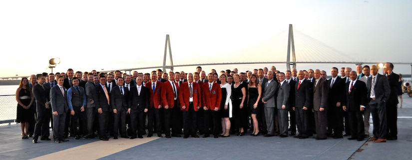 Members of the Global Eagles gather for a group photo during the Eagle Feather event on the USS Yorktown in Charleston, S.C., on Sept. 19, 2015. This year was the 15th Airlift Squadron's 75th anniversary and part of the celebration was the induction of six new members to the Hall of Fame.