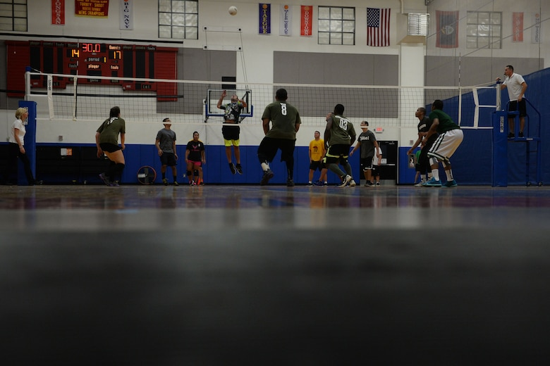 Joshua Corpening, 36th Operations Support Squadron attempts to spike a ball during the 2015 intramural volleyball championship game Sept. 29, 2015, at Andersen Air Force Base, Guam. The 36th Security Forces Squadron's team took home the first place trophy after winning 15-7 in the tiebreaker set. (U.S. Air Force by Senior Airman Joshua Smoot/Released)