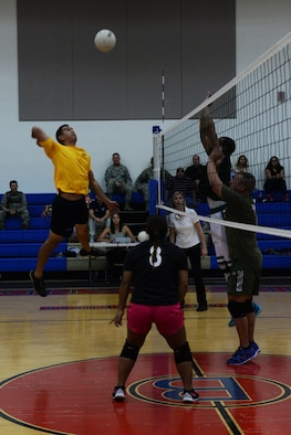 James Dela Pena, 36th Operations Support Squadron, attempts to spike a ball during the 2015 intramural volleyball championship game Sept. 29, 2015, at Andersen Air Force Base, Guam. Airmen assigned to the 36th Security Forces Squadron took home the first place trophy after winning the tiebreaker set 15-7. (U.S. Air Force by Senior Airman Joshua Smoot/Released)