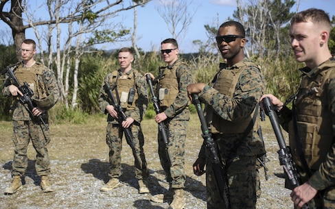 U.S. Marines with 3D Intelligence Battalion, 3D Marine Headquarters Group, and III Marine Expeditionary Force Band pay attention to instructions on Camp Hansen, Okinawa, Japan, Jan. 31, 2016. CPX 16 is conducted to improve the III MEF's capabilities in intelligence and logistic operations, future planning, and combat readiness. (U.S. Marine Corps photo by MCIPAC Combat Camera Lance Cpl. Christian J. Robertson/Released)