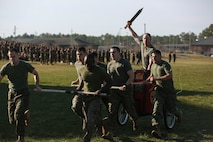 Commanders kicked off the field games with a tight battle during a chariot race. Commanders stepped on board with swords, unique helmets and chariots with decoration to represent the unit and its heritage for a two lap race around Elis Field.