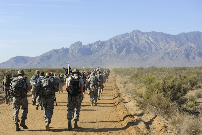 Airmen, carrying 35-pound rucksacks, participate in the 2016 Bataan Memorial Death March with 6,600 other participants March 20, 2016, at White Sands Missile Range, N.M. The 27th annual march was 26.2 miles long and served as a reminder for today's generation of the harsh conditions World War II veterans endured during their 60-mile march to a prisoner-of-war camp in the Philippines. (U.S. Air Force photo/Senior Airman Harry Brexel)