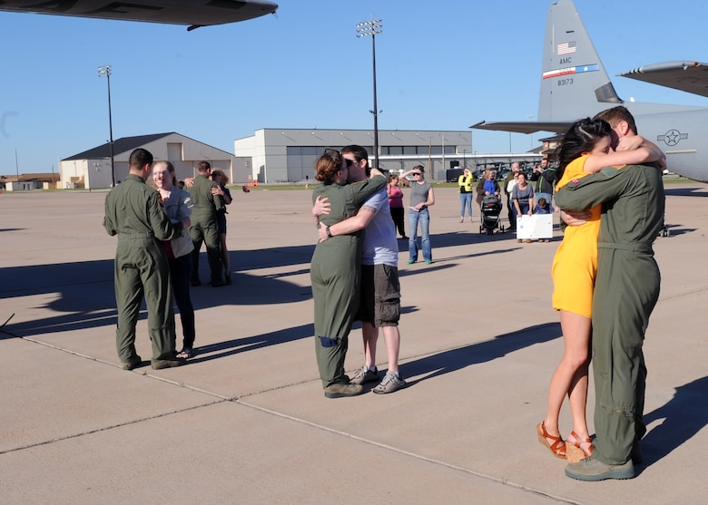 Airmen assigned to the 40th Airlift Squadron greet their family members March 21, 2016, at Dyess Air Force Base, Texas. The Airmen were deployed for three months supporting operations of European and African commands. (U.S. Air Force photo/Senior Airman Shannon Hall)