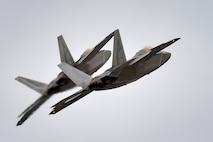 Two F-22 Raptors from the 3rd Wing at Joint Base Elmendorf-Richardson, Alaska, conduct approach training March 24, 2016. The F-22 is the Air Force's premium fifth-generation fighter asset. (U.S. Air Force photo/Justin Connaher)