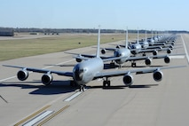 """Fourteen KC-135 Stratotankers line up during a simulated alert call March 24, 2016, at McConnell Air Force Base, Kan. Known as the """"elephant walk,"""" the alert call was part of an exercise, which displayed the rapid mobility capabilities and teamwork of the men and women at McConnell AFB to take flight within minutes of being notified of a mission. (U.S. Air Force photos/Airman 1st Class Christopher Thornbury)"""