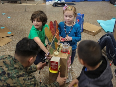 Students at DeLalio Elementary School participate in the Cardboard Box Challenge, a global Science, Technology, Engineering and Math education event, March 10. After creating an arcade out of cardboard and other recyclable materials, the students invited friends in family to come play the games.