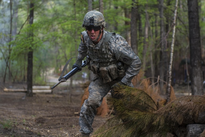 Staff Sgt. Brian Dolan, Co. B, Special Troops Bn., 171st Inf. Bde., rushes to his next position during while taking direct fire on the third day of testing at the Expert Infantry Badge qualification held on Ft. Jackson, S.C., March 31, 2016. Soldiers vying for the coveted Infantry qualification were given 30 timed Army Warrior tasks to complete in addition to being tested on the Army Physical Fitness test, day and night land navigation. Testing ends on April 1 with a 12-mile forced march. (U.S. Army photo by Sgt. 1st Class Brian Hamilton/released)
