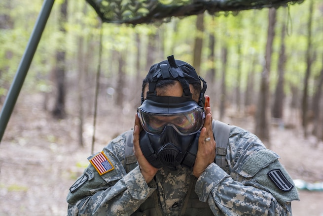 Staff Sgt. Juan Salgado, Co. A., 3rd Bn. 60th Inf. Reg., checks the seal on his protective mask during round robbin testing at the Expert Infantry Badge qualification held on Ft. Jackson, S.C., March 31, 2016. Soldiers vying for the coveted Infantry qualification were given 30 timed Army Warrior tasks to complete in addition to being tested on the Army Physical Fitness test, day and night land navigation. Testing ends on April 1 with a 12-mile forced march. (U.S. Army photo by Sgt. 1st Class Brian Hamilton/released)