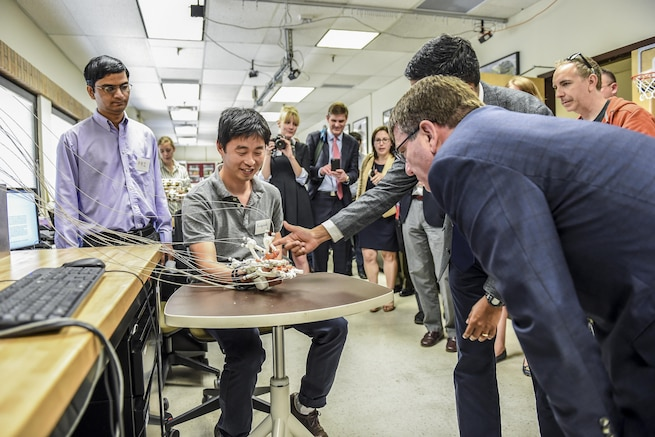 Defense Secretary Ash Carter, right, looks closely at a robotics demonstration as he tours the Rehabilitation and Neuromuscular Robotics Lab at the University of Texas at Austin, March 31, 2016. DoD photo by Army Sgt. 1st Class Clydell Kinchen