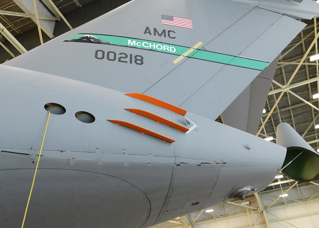 The first phase of C-17 Globemaster III drag reduction testing consisted of putting six orange Finlets on the aft part of the fuselage. A C-17 on loan from Joint Base McChord-Lewis, Washington, is the test plane for the program. With three Finlets on each side, test sorties were conducted to see how the C-17 performed with the modification. (U.S. Air Force photo/Kenji Thuloweit)