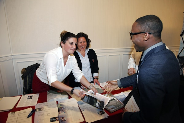 Engineers Dara Gay and Coral Sigilato pass out information at the Engineer's Week Celebration in Boston, Massachusetts on Feb. 25, 2016.