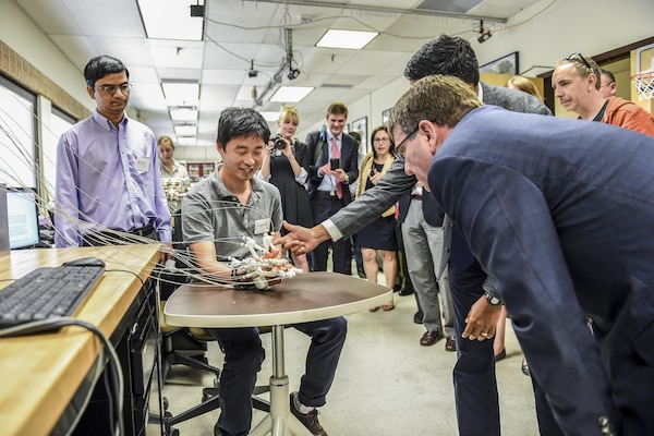 Defense Secretary Ash Carter, right, watches a robotics demonstration during a tour of the Rehabilitation and Neuromuscular Robotics Lab at the University of Texas at Austin, March 31, 2016. The Texas visit was part of a multistate trip that also included a stop today in Cambridge, Mass., and is part of the DoD effort to partner with the private sector and academia to ensure the United States continues to lead in the new frontiers of technology. DoD photo by Army Sgt. 1st Class Clydell Kinchen