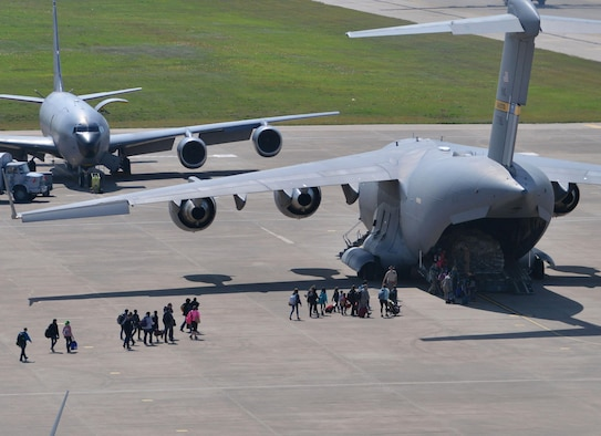 Families of U.S. Airmen and Defense Department civilians board a C-17 Globemaster III during an ordered departure March 30, 2016, at Incirlik Air Base, Turkey. On March 29, 2016, the secretary of defense, in coordination with the secretary of state, ordered the departure of all DOD dependents assigned to Incirlik AB. (U.S. Air Force photo/Senior Airman John Nieves Camacho)