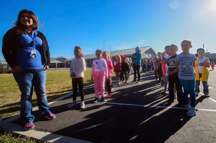 MARINE CORPS BASE CAMP PENDLETON, Calif. – Lydia Meza-Magallanes lines up her students for the Physical Education Fitness Challenge at North Terrace Elementary, March 25, 2016. Approximately 30 Marine volunteers with the Single Marine Program facilitated a series of exercises and competitions including an obstacle course relay race and tug-of-war. The challenge encourages children to stay active and helps Marines engage with their local community. Meza-Magallanes, a native of Fillmore, Calif., is a kindergarten teacher at North Terrace Elementary. (U.S. Marine Corps photo by Lance Cpl. Caitlin Bevel/RELEASED)