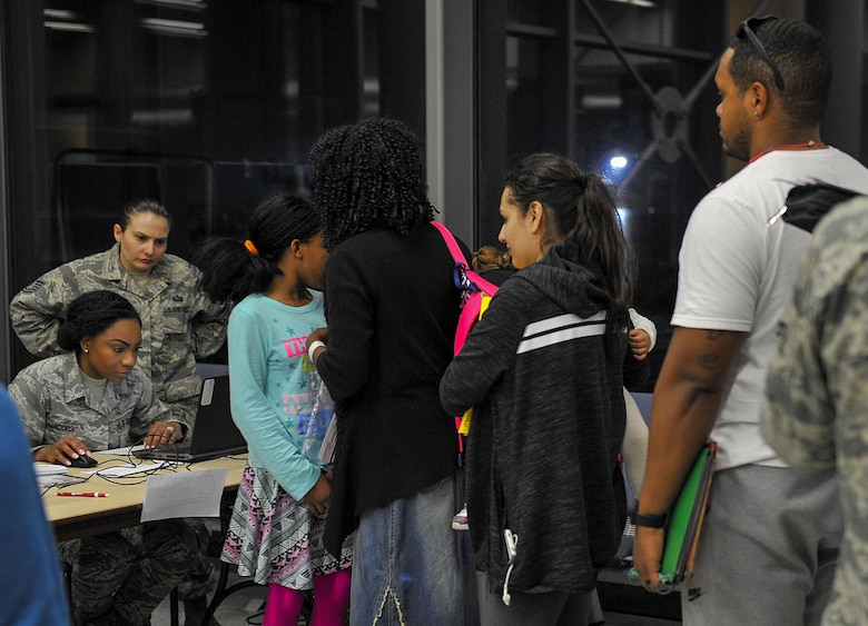 Families arriving from Turkey check-in March 31, 2016, at Ramstein Air Base, Germany. Many agencies provided assistance by offering food, transportation and any needs families arriving from military bases in Turkey may have required. (U.S. Air Force photo/Senior Airman Larissa Greatwood)