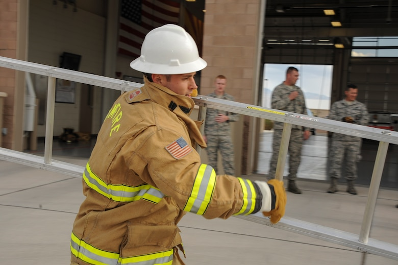 U.S. Air Force 2nd Lt. Justin Trampota, 355 Logistics Readiness Squadron officer in charge of vehicle management, performs a ladder carry during the Comprehensive Airman Fitness Month Fire Department Fitness Challenge at Davis-Monthan Air Force Base, Ariz., March 31, 2016. Participants demonstrated their physical resilience through exercises such as dummy drags, tool carries and fire hydrant charging. (U.S. Air Force photo by Airman 1st Class Mya M. Crosby/Released)