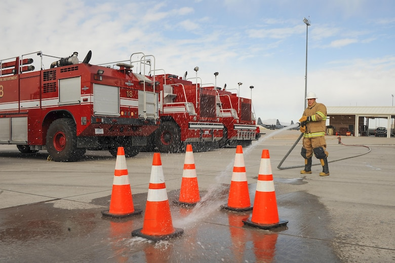 U.S. Air Force Airman 1st Class Dylan Nigren, 355th Logistics Readiness Squadron fire truck and refueling journeyman, utilizes a fire hose during the Comprehensive Airman Fitness Month Fire Department fitness challenge at Davis-Monthan Air Force Base, Ariz., March 31, 2016. Participants demonstrated their physical resilience through exercises such as dummy drags, tool carries and fire hydrant charging.. (U.S. Air Force photo by Airman 1st Class Mya M. Crosby/Released)