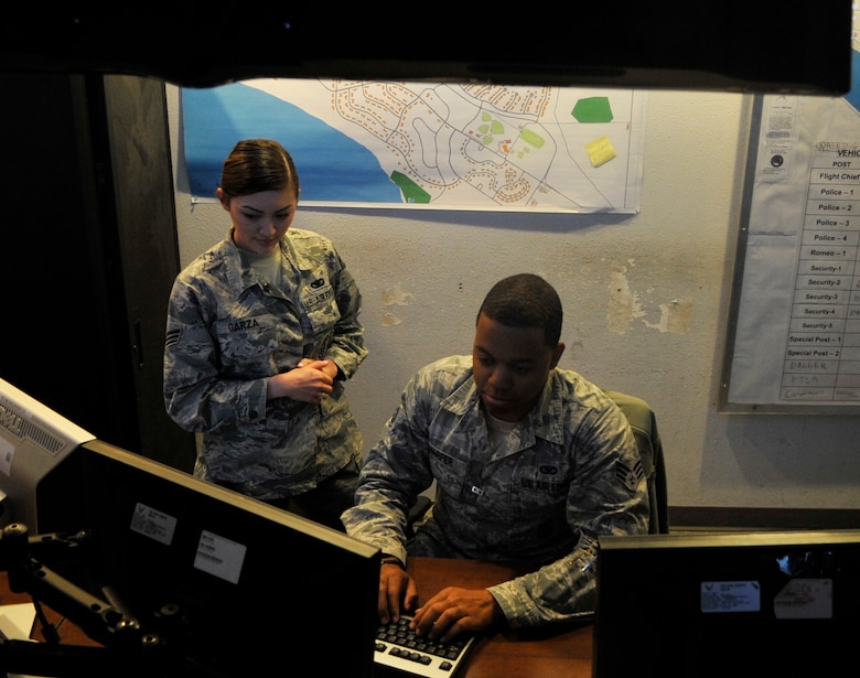 Senior Airman Baso Harper, 325th Security Forces Squadron electronic security systems NCO in charge, conducts daily status checks on 2,805 alarm points March 7, 2016, at the Base Defense Operations Center. Harper is in charge of the electronic security systems section and monitors 2,805 alarm points, 102 alarmed areas and nine restricted areas. He also assures alarms are at those areas at all times, and makes sure that approximately 200 base personnel do quarterly alarm checks on their facilities. (U.S. Air Force photo by Senior Airman Sergio A. Gamboa/Released)