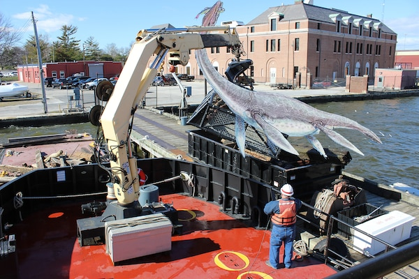 Debris Vessel Reynolds works to clear Chessie the Chesapeake Bay sea monster from the Baltimore Harbor Friday morning April 1, 2016.