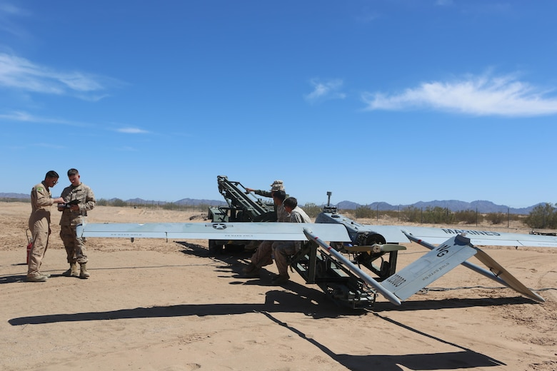 Marines with Marine Unmanned Aerial Vehicle Squadron (VMU) 1 perform function checks for the flight of the RQ-7Bv2 Shadow, an unmanned aerial system, at the Cannon Air Defense Complex in Yuma, Ariz., March 25. Marine Wing Support Squadron (MWSS) 371 and MWSS-274 supported VMU-1 by building a runway in preparation for the Shadow's first flight at the site. (U.S. Marine Corps photo by Lance Cpl. Harley Robinson/Released)